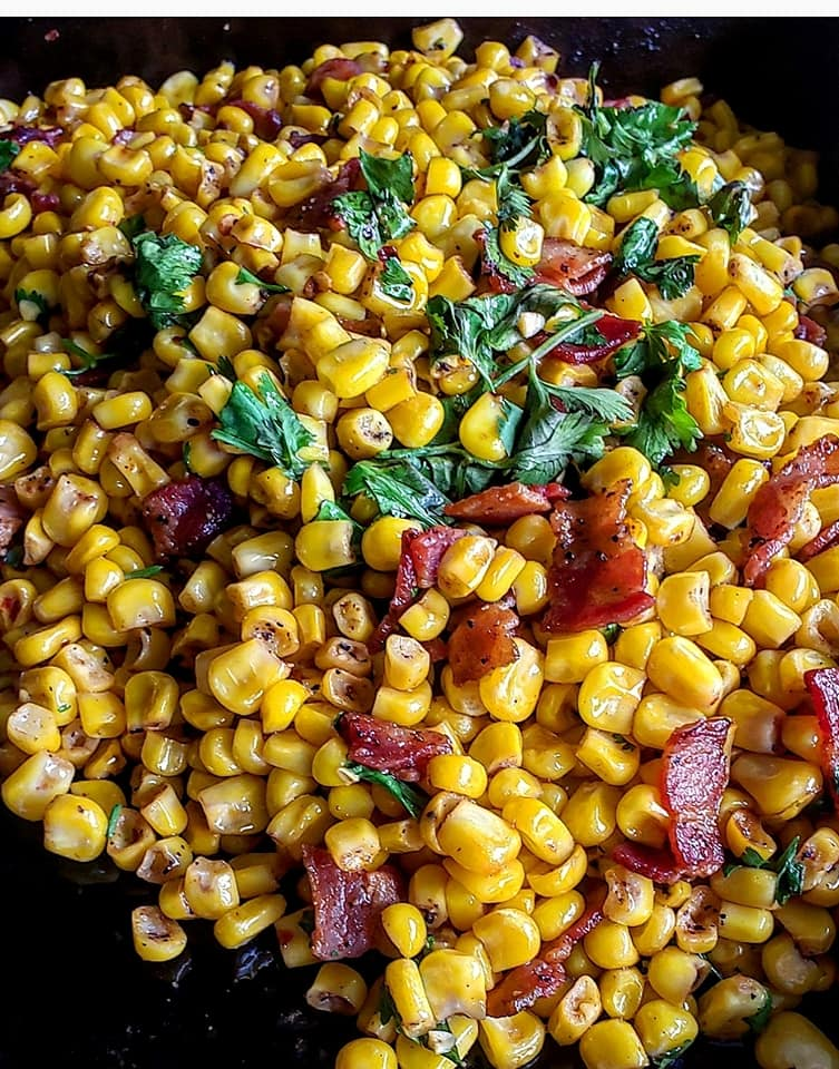Bacon-fried corn featuring cilantro, garlic paste and Blackstone taco seasoning