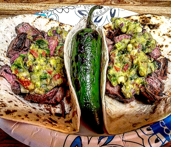 Carne asada tacos with flank steak